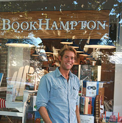 Perry Moore outside a bookstore displaying HERO